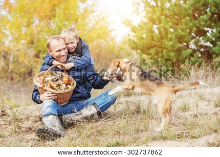 Happy family spent free time in autumn forest - stock photo