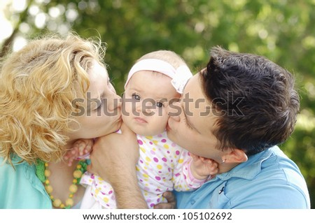 Happy family sun summer day in the park - stock photo