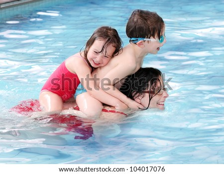Happy family swimming in a pool. - stock photo