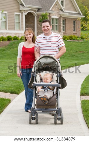 Happy Family Taking a Walk - stock photo