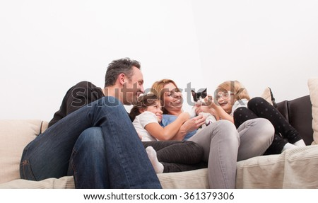 Happy family time in the living room on the couch or sofa - stock photo