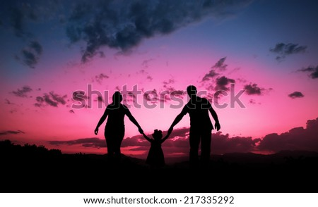 Happy family together hand in hand  - stock photo