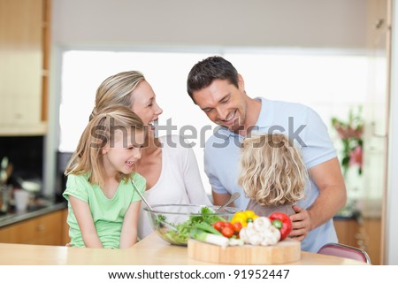 Happy family together in the kitchen - stock photo