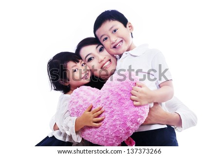 Happy family together looking at camera on white background - stock photo