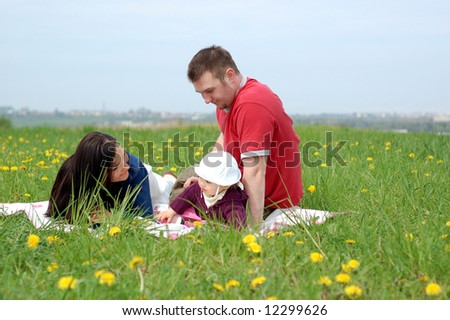 happy family together on green meadow