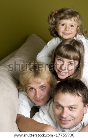 Happy family together on sofa