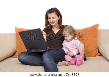 happy family together on sofa with laptop - stock photo
