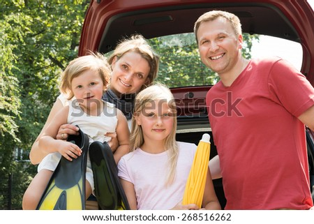 Happy Family Traveling By Car. Outdoors Shot - stock photo