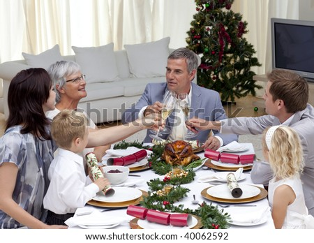 Happy family tusting in a Christmas dinner at home