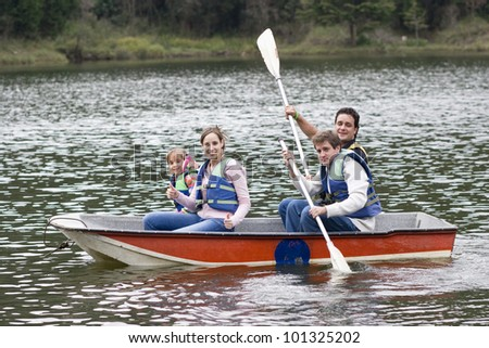 Happy Family, Uncle, Mother,Father and Daughter Enjoying on Lake - stock photo
