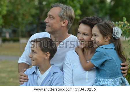 happy family walking in the autumn park closeup - stock photo
