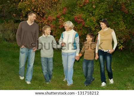 happy family walking in the park in autumn - stock photo