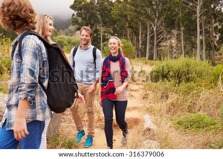 Happy family walking out of a forest