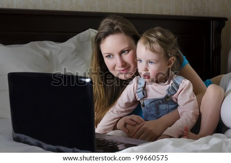 Happy family watching a cartoon on the laptop