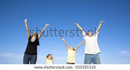 happy family watching the blue sky - stock photo