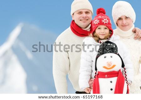Happy family winter holiday - copy space - stock photo