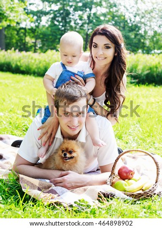 happy family with a baby having a picnic in the park