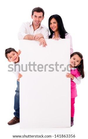 Happy family with a banner - isolated over a white background - stock photo