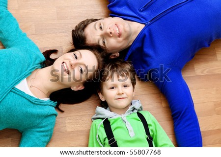 Happy family with a child at home. - stock photo