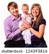 happy family with baby on white background - stock photo