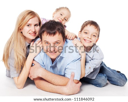 Happy family with children isolated on white background. Parents with boy and girl studio shot - stock photo