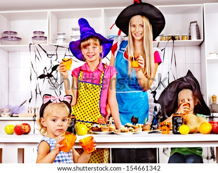 Happy family with children preparing halloween food.