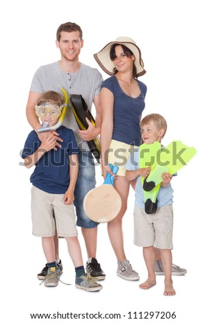 Happy family with children ready for vacation. Isolated on white - stock photo