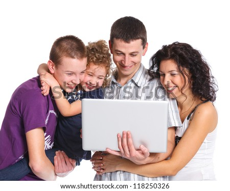 Happy family with children using on laptop computer - stock photo