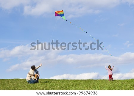 happy family with colorful kite on sky background - stock photo