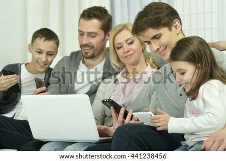 happy family with electronic gadgets