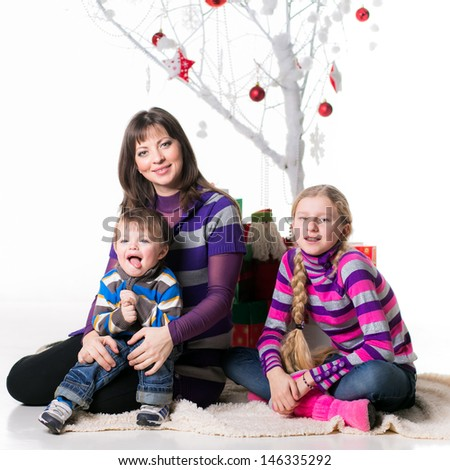 happy family with gifts under the Christmas tree