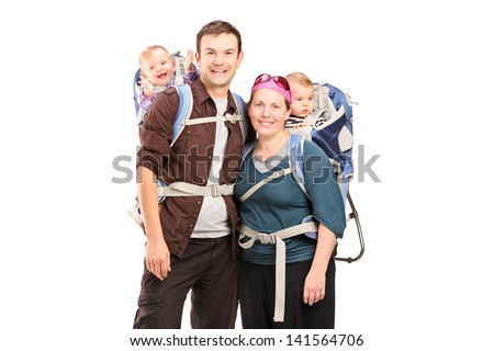 Happy family with hiking backpacks posing isolated on white background - stock photo