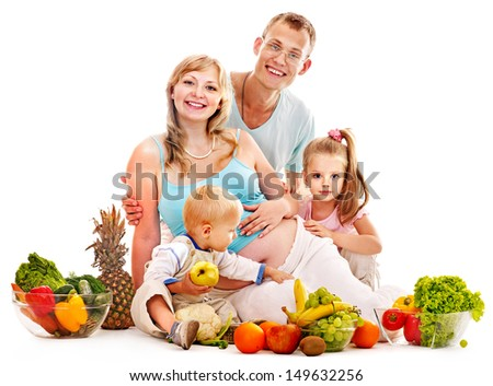 Happy family with pregnant woman and kid preparing food. Isolated.