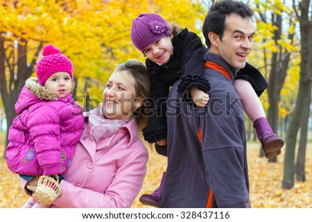 happy family with smiling faces outdoors  - stock photo