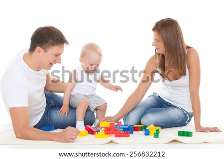 Happy family with sweet baby play on a white background. - stock photo