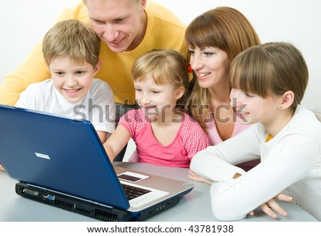 Happy family with the laptop - stock photo