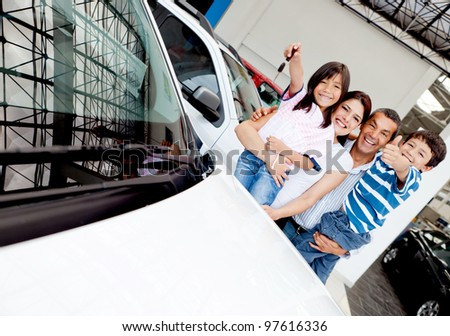 Happy family with their new car t the dealer - stock photo