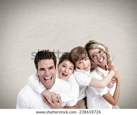 Happy family with two boys near grey wall - stock photo