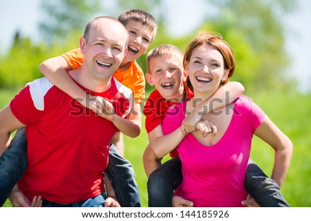 Happy family with two children on nature - happiness concept - stock photo