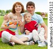 Happy family with two children outdoor - stock photo