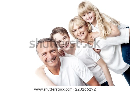 Happy family with two children posing together to camera