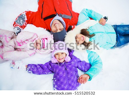 happy family with two kids outdoor in the winter park