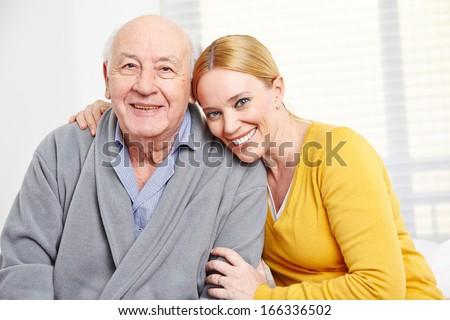 Happy family with woman embracing senior citizen man - stock photo