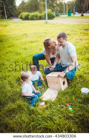 Happy family with Wooden birdhouse