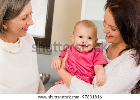 Happy family women - grandmother, mother and baby make funny face - stock photo