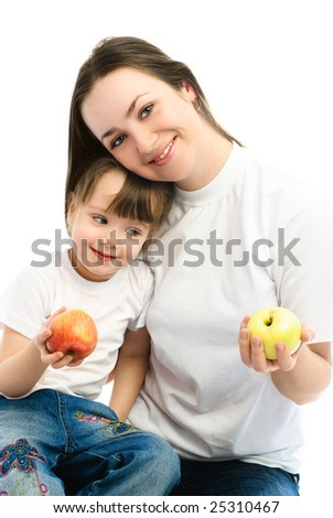 happy family, young beautiful mother and her daughter eating apples