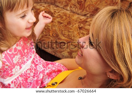 happy family, young beautiful mother and her little daughter indoor at home - stock photo