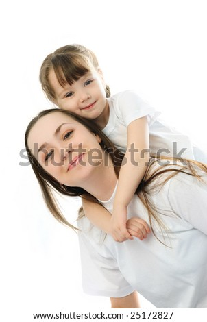 happy family, young beautiful mother giving her daughter piggyback ride - stock photo