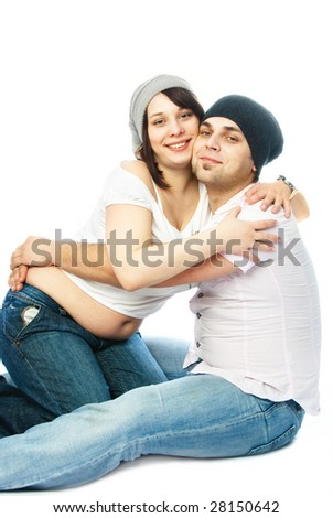 happy family, young pregnant woman and her husband embracing - stock photo