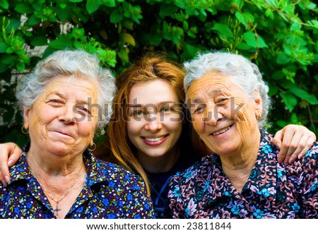 Happy family - young woman and two senior ladies - stock photo